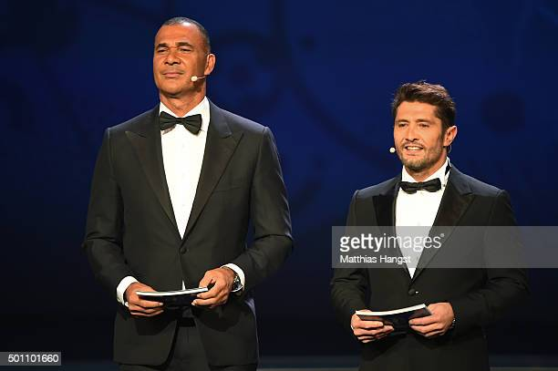 Hosts Ruud Gullit and Bixente Lizarazu are seen on stage during the UEFA Euro 2016 Final Draw Ceremony at Palais des Congres on December 12 2015 in...
