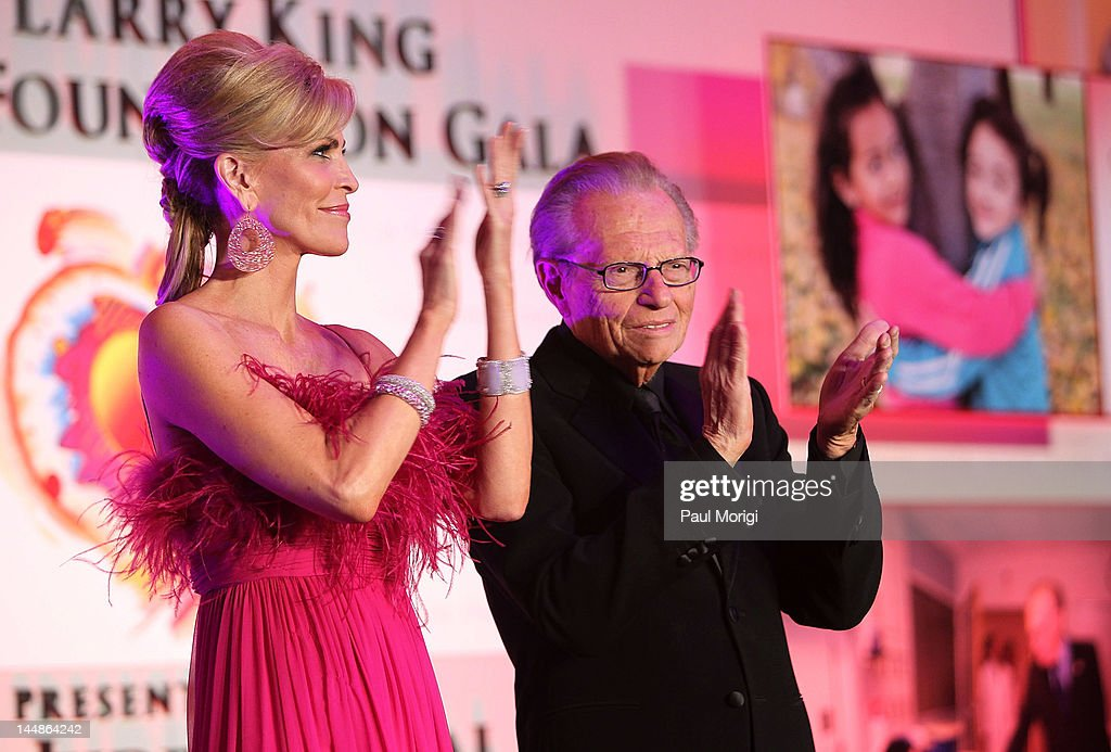 Hosts Shawn King (L) and <a gi-track='captionPersonalityLinkClicked' href=/galleries/search?phrase=Larry+King&family=editorial&specificpeople=202014 ng-click='$event.stopPropagation()'>Larry King</a> applaud on stage during the 18th Annual <a gi-track='captionPersonalityLinkClicked' href=/galleries/search?phrase=Larry+King&family=editorial&specificpeople=202014 ng-click='$event.stopPropagation()'>Larry King</a> Cardiac Foundation Gala at Ritz Carlton Hotel on May 19, 2012 in Washington, DC.
