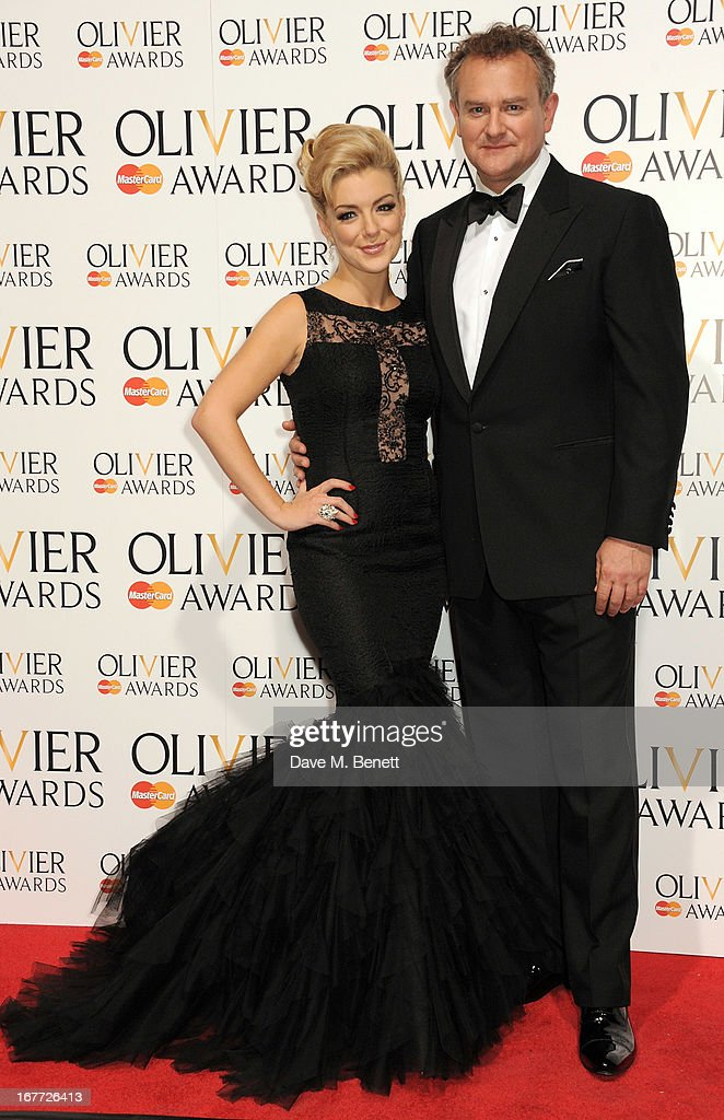 Hosts Sheridan Smith (L) and Hugh Bonneville pose in the press room at The Laurence Olivier Awards 2013 at The Royal Opera House on April 28, 2013 in London, England.