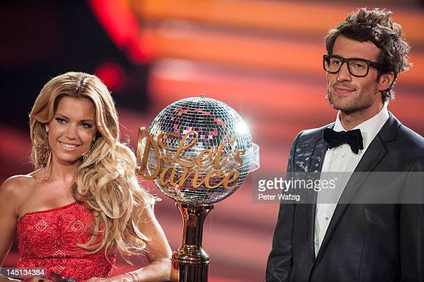 Hosts Sylvie van der Vaart and Daniel Hartwich together with the trophy during 'Let's Dance' Finals at Coloneum on May 23 2012 in Cologne Germany
