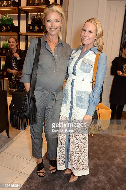 Hosts Tamara Beckwith and Alice Naylor Leyland attend the Coach Fall 2014 Collection Launch at their New Bond Street store on September 18 2014 in...