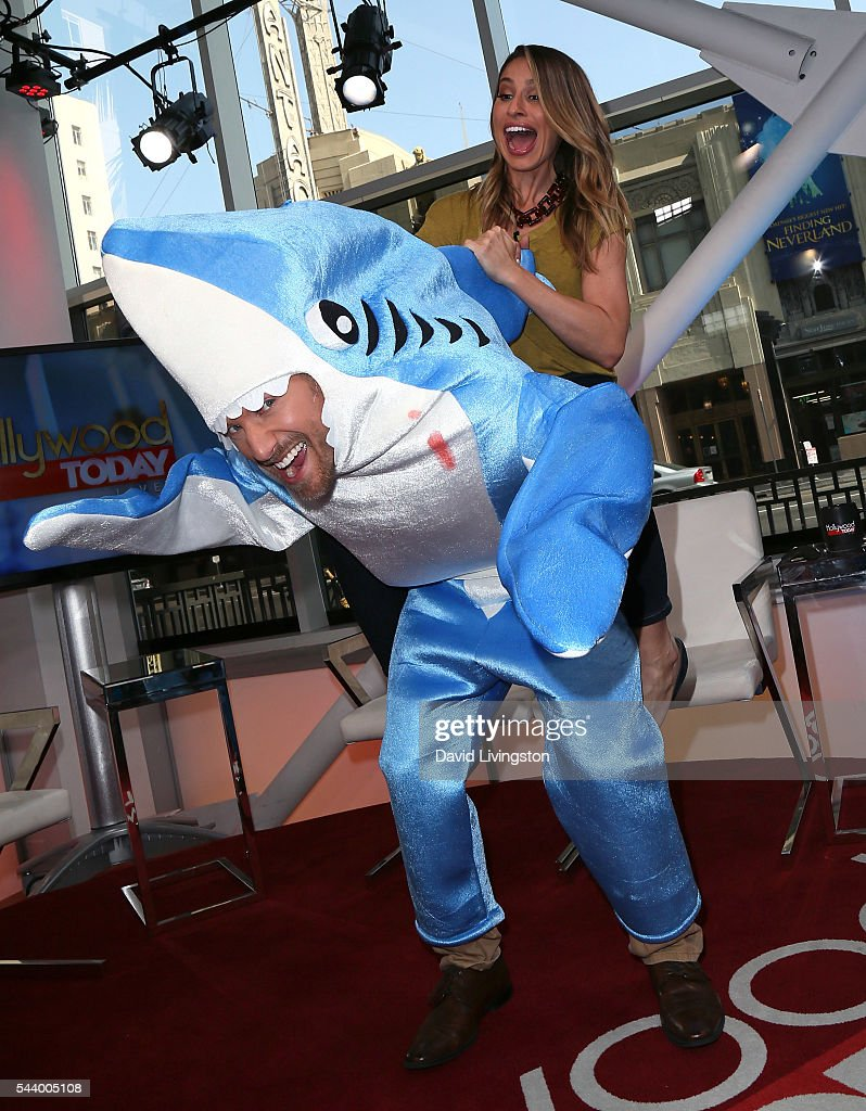 Hosts Tanner Thomason (in shark suit) and Kristen Brockman pose at Hollywood Today Live at W Hollywood on June 30, 2016 in Hollywood, California.
