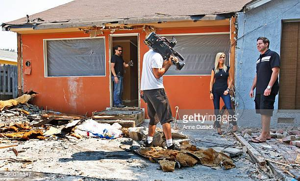 TV hosts Tarek El Moussa right and his wife Christina El Moussa second from right talk during filming of HGTV's 'Flip or Flop' reality TV show as...