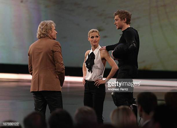 TV hosts Thomas Gottschalk and Michelle Hunziker chat with Samuel Koch during the 192th 'Wetten dass ' show at the exhibition hall Dusseldorf on...