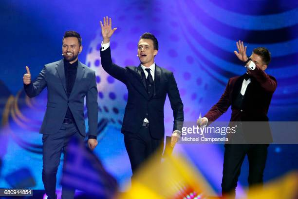 Hosts Timur Miroshnychenko Oleksandr Skichko and Volodymur Ostapchuk speak on stage during the first semi final of the 62nd Eurovision Song Contest...