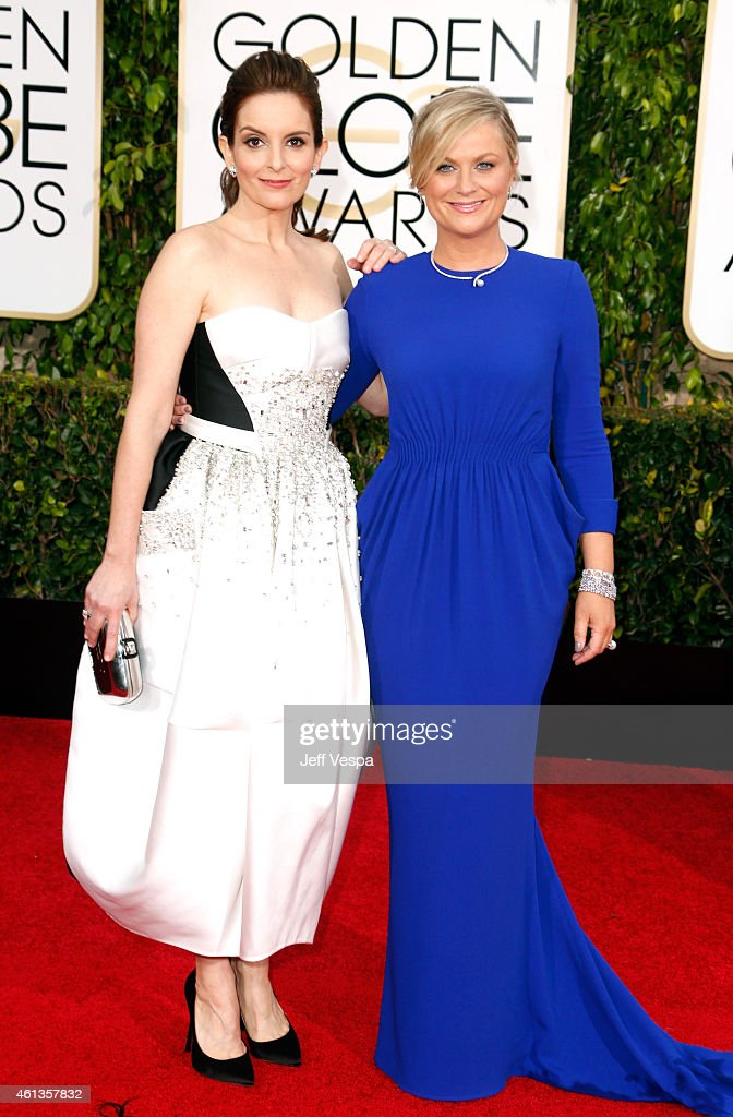 Hosts Tina Fey and Amy Poehler attend the 72nd Annual Golden Globe Awards at The Beverly Hilton Hotel on January 11 2015 in Beverly Hills California