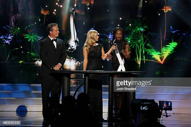 Hosts Todd Newton and Former Miss Wisconsin Alex Wehrley speak onstage with Miss Maryland Mame Adjei at the 2015 Miss USA Pageant Only On...