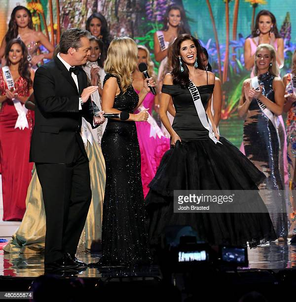 Hosts Todd Newton and Former Miss Wisconsin Alex Wehrley speak with Most Photogenic winner Miss Indiana Gretchen Reece onstage at the 2015 Miss USA...