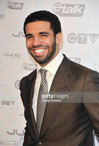 Host/singer Drake poses on the red carpet at the 2011 Juno Awards at the Air Canada Centre on March 27 2011 in Toronto Canada