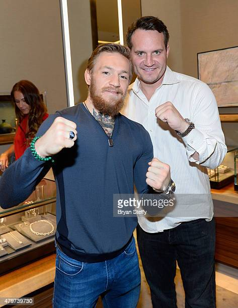 Host/VIP Conor McGregor and Big Knocout Boxing executive Ross Miller attend the David Yurman with Conor McGregor Hosts an InStore Event on July 6...