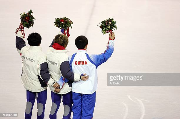 HoSuk Lee HyunSoo Ahn of Korea and Jia Jun Li of China wave to the crowd during the Flower Ceremony of the men's 1500m Short Track speed skating...