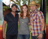 Hot 20 Countdown hosts Cody Alan and Alecia Davis welcomes Jason Aldean backstage at Country Thunder USA Day 4 on July 27 2014 in Twin Lakes Wisconsin