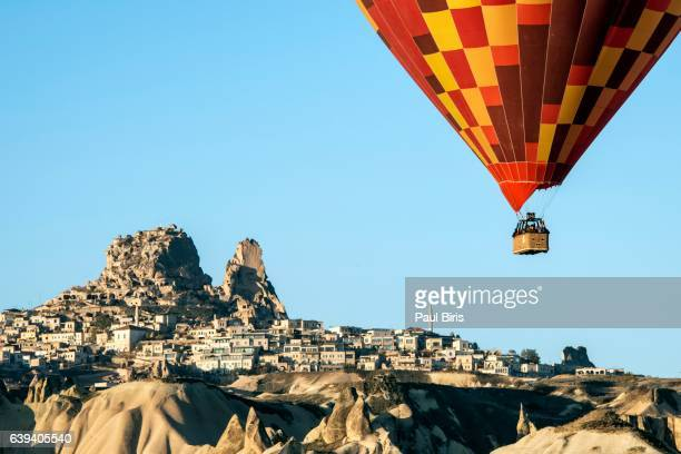 Hot air ballon and Uchisar Castle in Cappadocia, Turkey.
