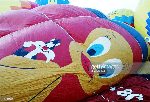 A hot air balloon decorated with the cartoon characters Tweety and Sylvester is prepared for a mass launch at the Albuquerque International Balloon...