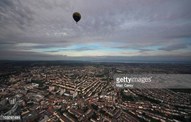 A hot air balloon flies above Bristol city centre on August 9 2010 in Bristol England The dawn flight was a preview for the International Balloon...