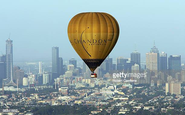A hot air balloon gently drifts over the city of Melbourne December 5 2005 in Melbourne Australia Hot air ballooning has become a popular activity in...