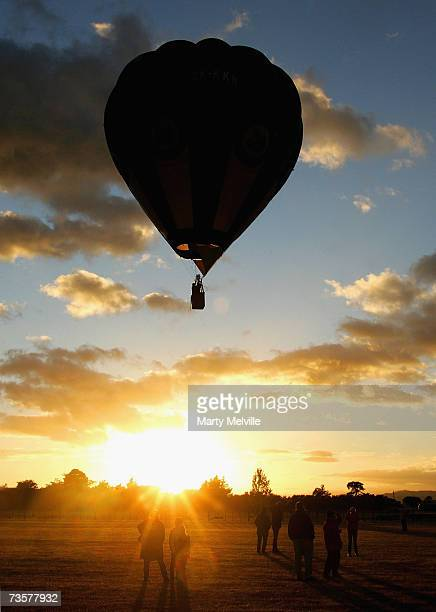 Hot Air Balloon glides over the crowds as part of the mass ascension during the Wairarapa International Hot Air Balloon Festival at Carterton March...