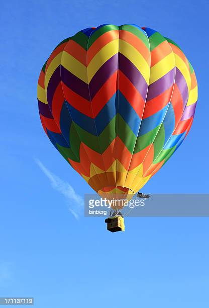 A hot air balloon in the clear, blue sky