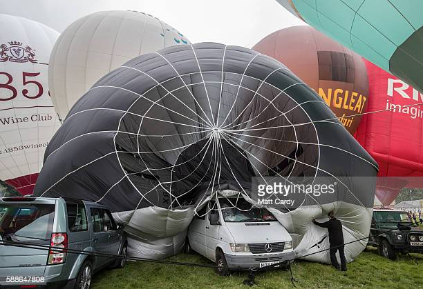 A hot air balloon is deflatated after being tethered in the main arena on the second day of the Bristol International Balloon Fiesta on August 12...