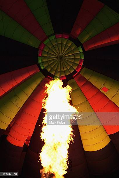 A hot air balloon is filled as it prepares to take to the air as part of the Sky Orchestra hot air balloon and musical flotilla performance in...