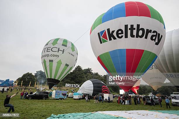A hot air balloon is inflatated and tethered in the main arena on the second day of the Bristol International Balloon Fiesta on August 12 2016 in...