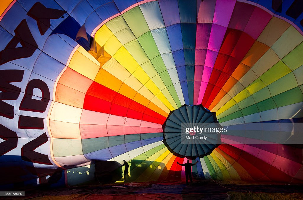 A hot air balloon is inflated at the Bristol International Balloon Fiesta main arena at the Ashton Court estate on August 7 2015 in Bristol England...