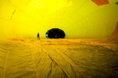 A hot air balloon is inflated at the European Balloon Festival on July 10 2014 in Igualada Spain The early morning flight of over 30 balloons was...