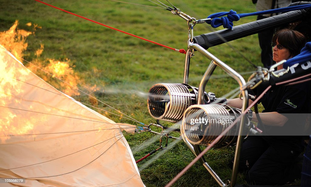 A hot air balloon is inflated during the 32nd Bristol International Balloon Fiesta at the Ashton Court Estate in Bristol on August 12 2010 AFP PHOTO/...
