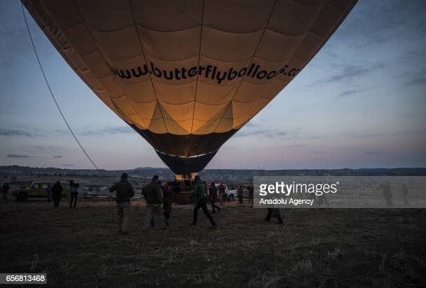 A hot air balloon is seen as Anadolu Agency's Visual News EditorinChief Ahmet Sel NOOR Images photojournalist Yuri Kozyrev founder of Shanghai Center...
