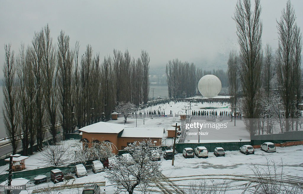 A hot air balloon is seen tied in a park after a snowfall on February 23, 2013 in Srinagar, Indian Administered Kashmir, India. Several parts of the Kashmir Valley, including the summer capital Srinagar, experienced fresh snowfall today, prompting the authorities to issue an avalanche warning and leading to closure of the Jammu-Srinagar Highway, the only road link between Kashmir and rest of India.