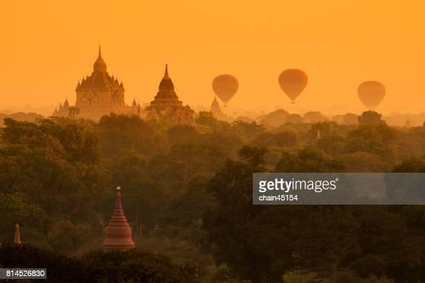 Hot air balloon over plain of Bagan in misty morning, Mandalay, Myanmar.