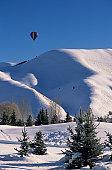 Hot air balloon over Snowy Mountains,  Sun Valley, Idaho, USA