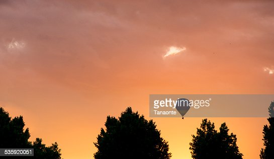 Hot air balloon silhouette at sunset : Stock Photo