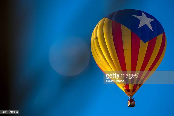 A hot air balloon with a Catalan proindependence flag flies over Igualada during an early flight as part of the European Balloon Festival on July 10...