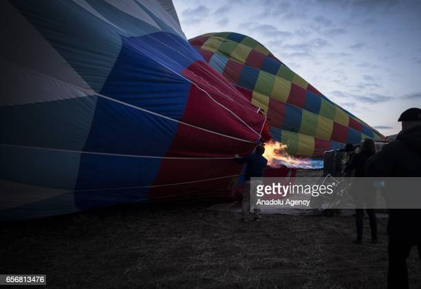 Hot air balloons are being prepared as Anadolu Agency's Visual News EditorinChief Ahmet Sel NOOR Images photojournalist Yuri Kozyrev founder of...