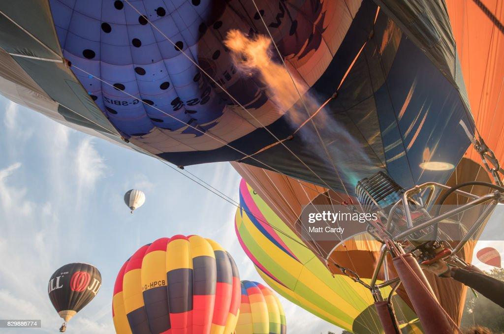 Hot air balloons are inflated and take to the skies as they participate in the mass assent at sunrise in the main arena on the second day of the Bristol International Balloon Fiesta on August 11, 2017 in Bristol, England. More than 130 balloons have gathered for the four day event, now in its 39th year and now one of Europe's largest annual hot air balloon events, being hosted in the city that is seen by many as the home of modern ballooning.