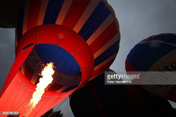 Hot air balloons are inflated in Queen Square ahead of the Bristol International Balloon Fiesta on August 5 2014 in Bristol England Now in its 36th...