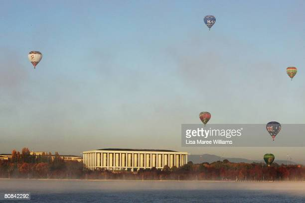 Hot air balloons are released into the sky to celebrate the start of the Olympic Torch relay at Parliament House on April 24 2008 in Canberra...