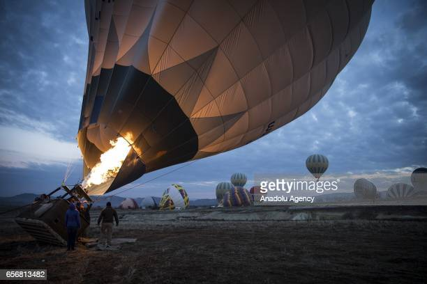 Hot air balloons are seen as Anadolu Agency's Visual News EditorinChief Ahmet Sel NOOR Images photojournalist Yuri Kozyrev founder of Shanghai Center...