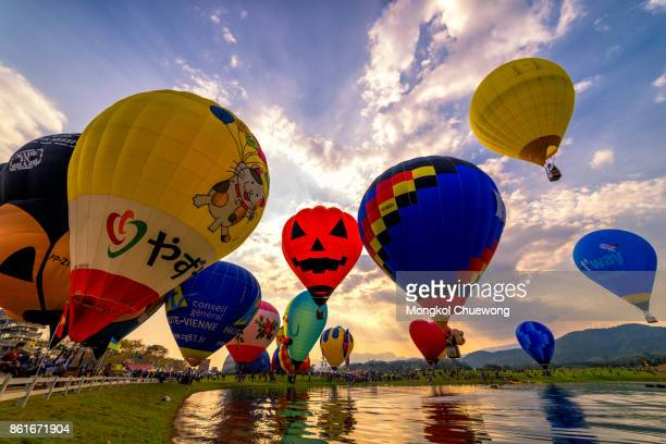 Hot air balloons at sunset in Singha park Chiangrai in Singhapark Chiangrai International BalloonFiesta 2017.