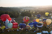 Hot air balloons depart from Aston Court in a mass ascent on the first full day of the Bristol International Balloon Fiesta on August 8 2014 in...