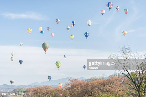 Hot air balloons floating in the spring sky