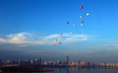 Hot air balloons fly across Qiongzhou Strait in Haikou south China's Hainan province during the H1 China Hot Air Balloon Challenge on June 18 2013...