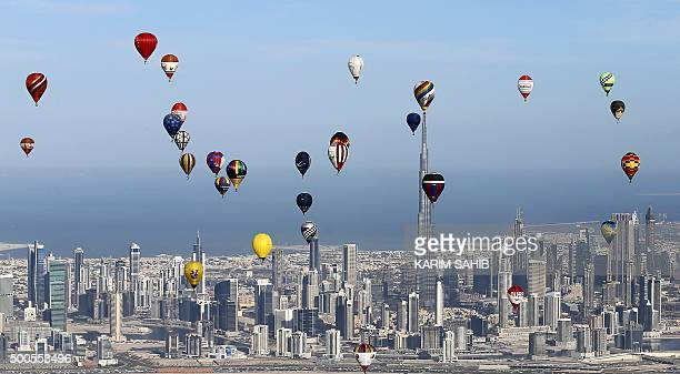 Hot air balloons fly over Dubai during the World Air Games 2015 held under the rules of the Federation Aeronautique International as part of the...
