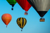 Hot air balloons fly over Igualada during an early flight as part of the European Balloon Festival on July 10 2014 in Igualada Spain The early...
