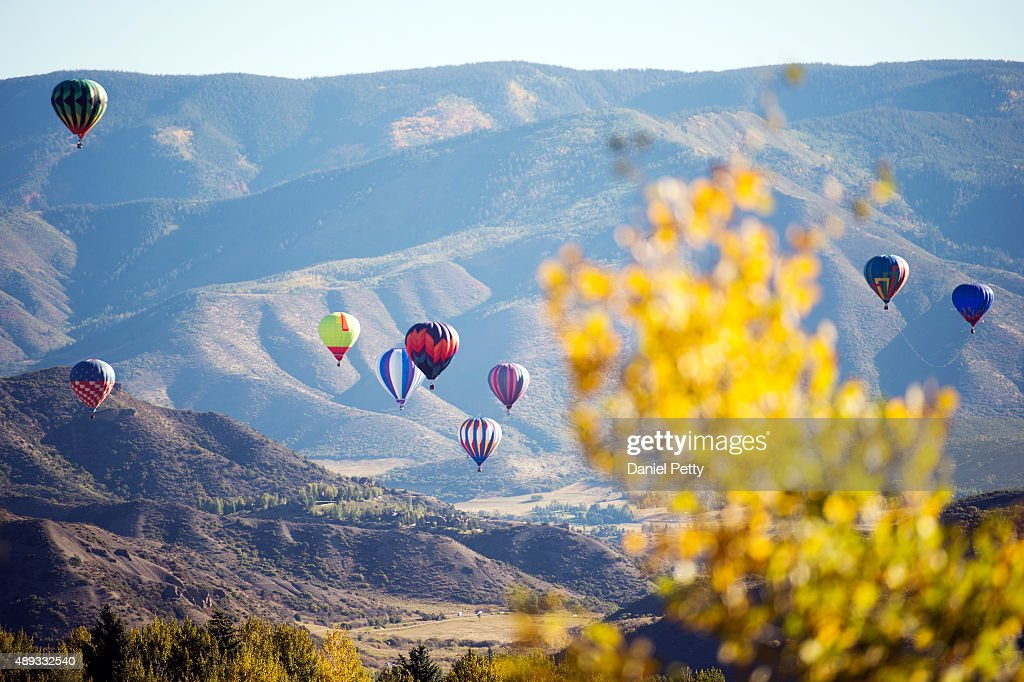Hot air balloons fly over Snowmass Village during the 40th annual Snowmass Balloon Festival on September 20 2015 in Snowmass Village Colorado