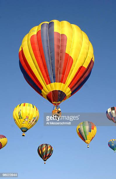 Hot air balloons fly overhead during a morning ascent at the Albuquerque International Balloon Fiesta on October 8 2005
