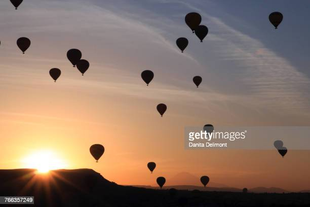 Hot air balloons flying above rock formations, Goreme National Park, Goreme, Cappadocia, Anatolia, Turkey