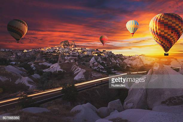 Hot air balloons flying over cappadocia.