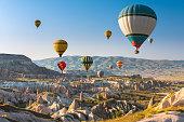 Hot air balloons flying in sunset sky Cappadocia, Turkey